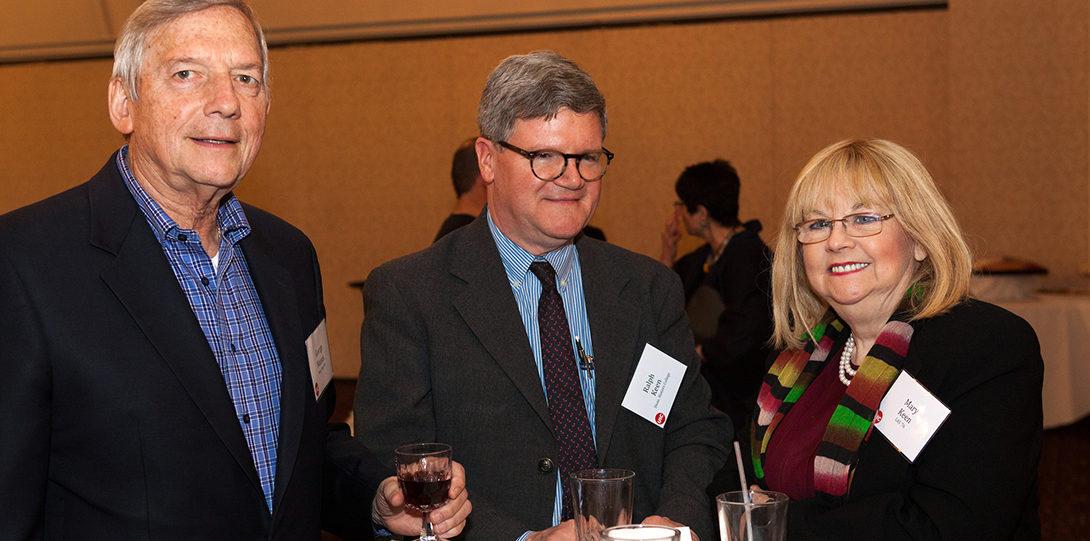 Three alumni smile at the North Shore networking event