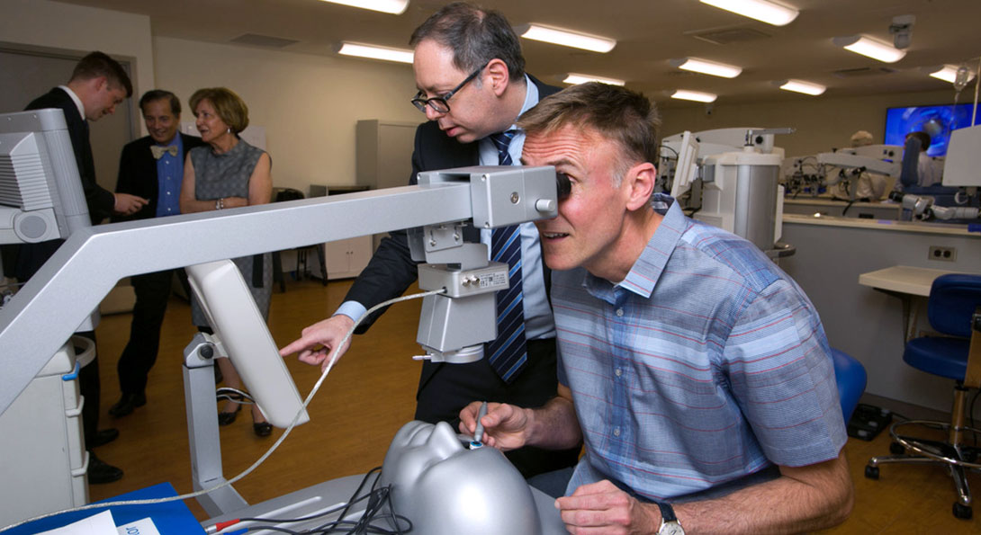 Person looking through a simulation microscope