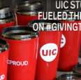 Coffee cups lined up next to the free coffee and hot chocolate line at #GivingTuesday