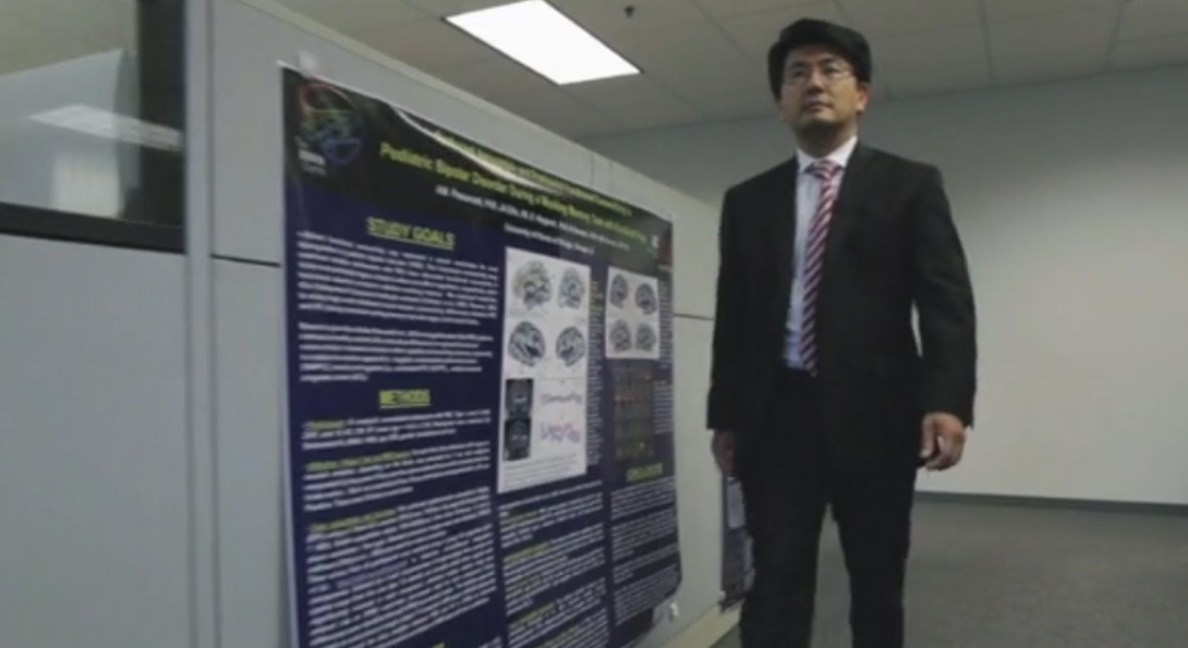 Dr. Luan Phan walking down a hallway.