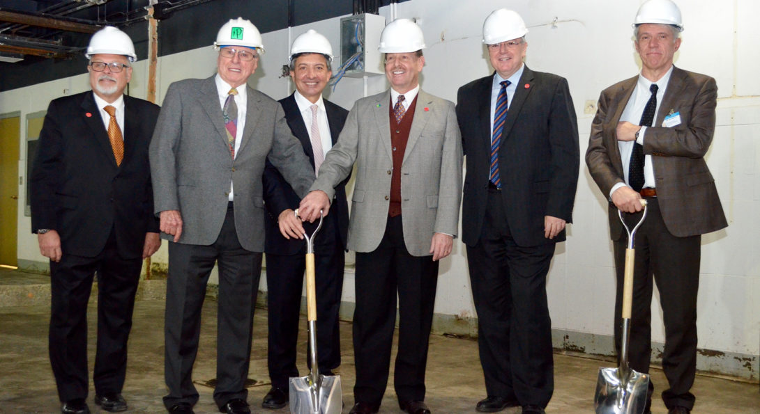 gentlemen with shovels gather for surgical, robotic center groundbreaking