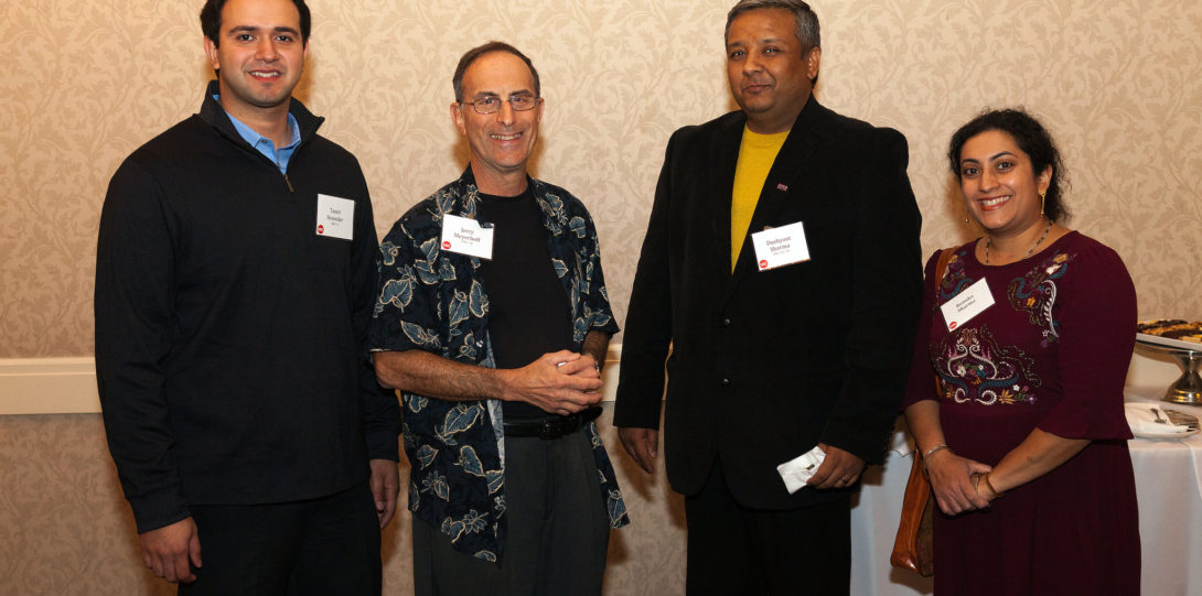 Alumni gather to smile at the networking event