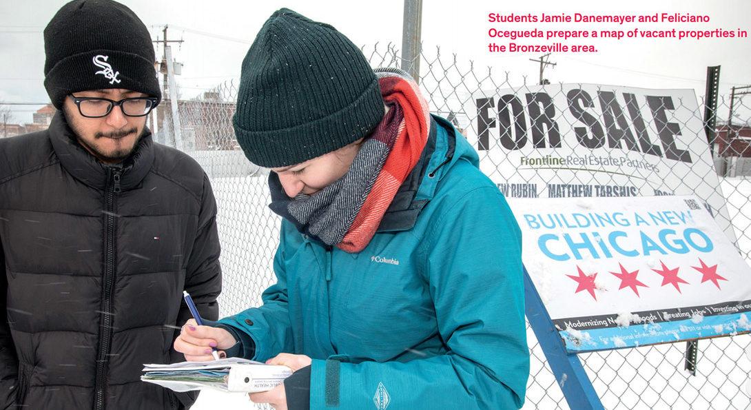 Students Jamie Danemayer and Feliciano Ocegueda prepare a map of vacant properties in the Bronzeville area.