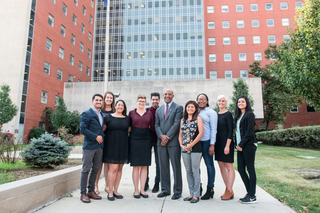 dean giles with students outside the school of public health
