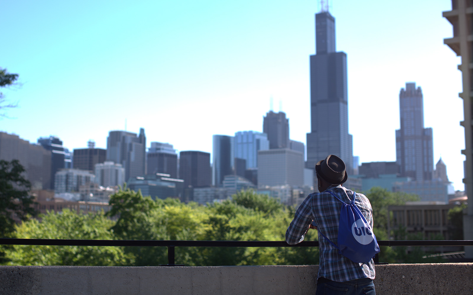 person looking at Chicago skyline