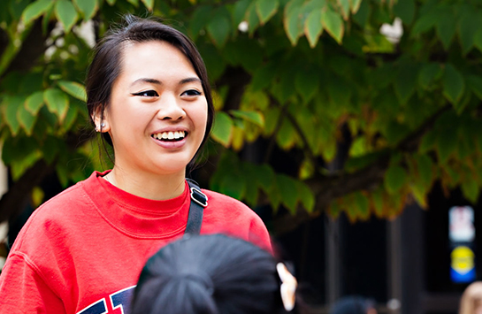 student smiling on quad
