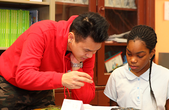 UIC Engage tutor working with CPS student
