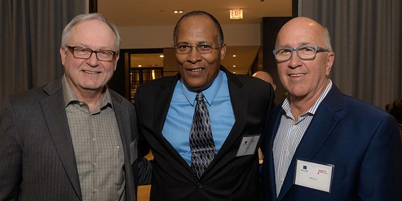 Professor James Gleeson MSW '84 (left), Jim Jones MSW '83 (middle) and donor Jim Horan MSW '79 (right) celebrate the Professor James P. Gleeson Scholarship Fund at Gleeson's retirement party in October 2017