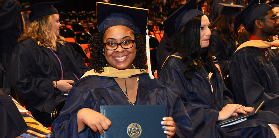 2018 Spring Commencement - Alumna shows off diploma