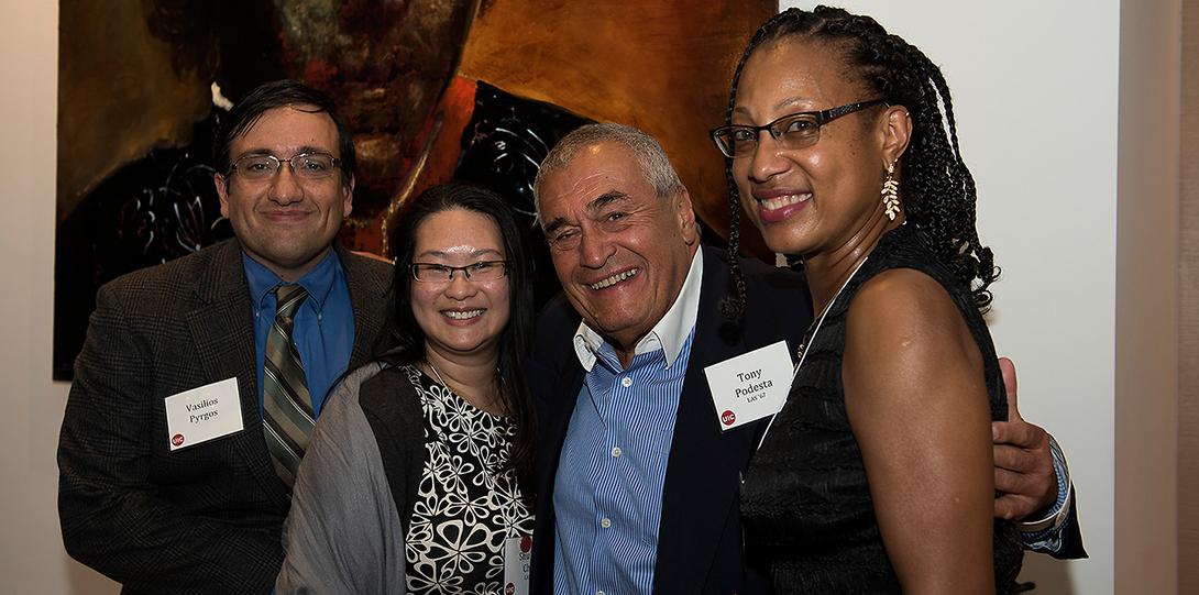 Alumni with Washington DC alumni event host Tony Podesta