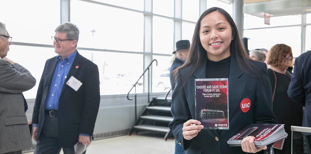 Student Ambassador showing off the event program