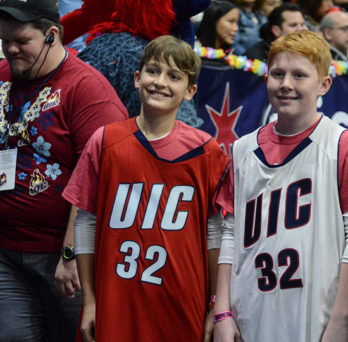 kids wearing uic flames jerseys