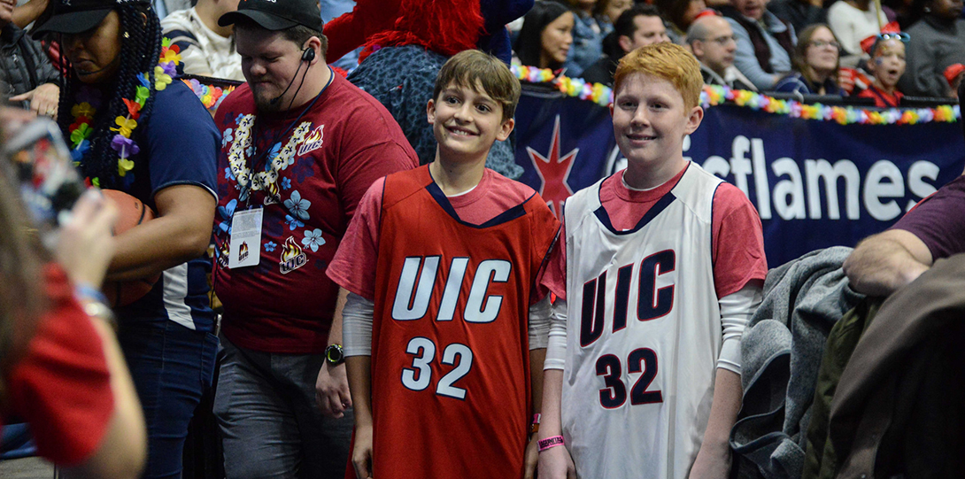 kids wearing uic flames jerseys