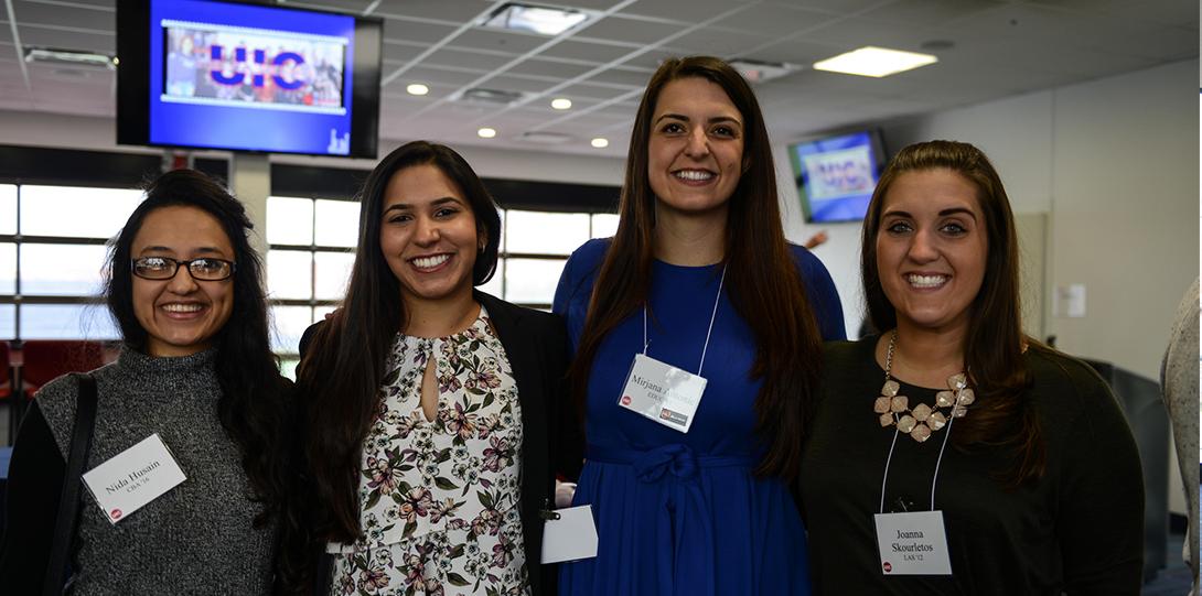 alumni posing for photo at reception