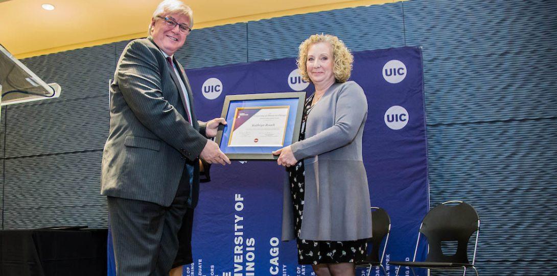 Chancellor Michael Amiridis presents awards at the 2019 UIC Alumni Award Celebration