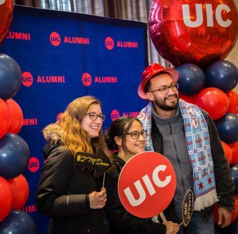 Students posing with UIC sign