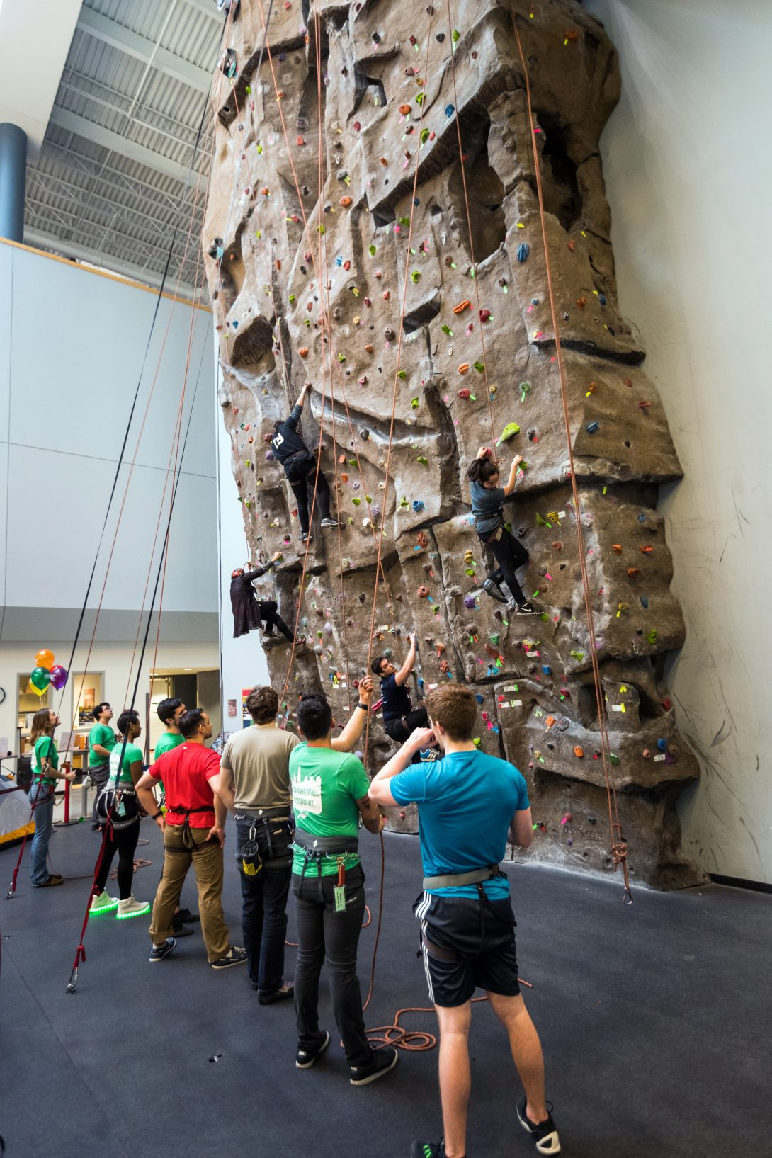 People at rock climbing wall in campus recreation center