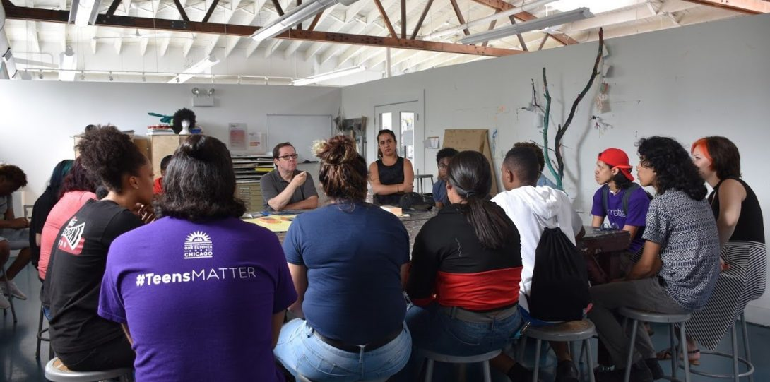 Jim Duignan works with interns at SkyART in south Chicago