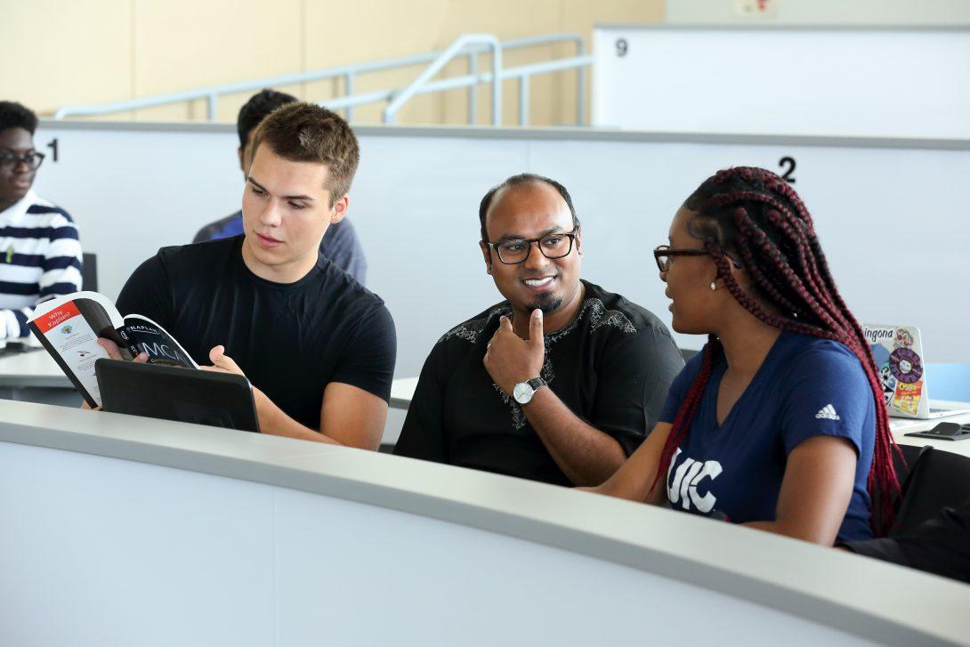 Three students in a seminar