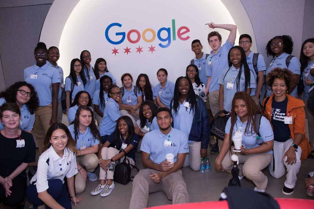 A group of students in front of Google sign