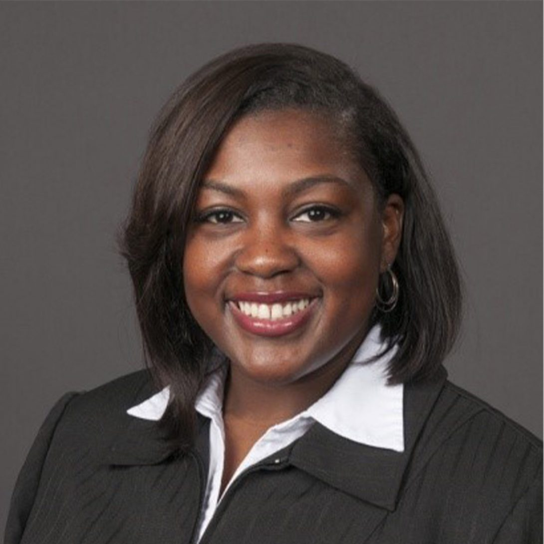 Woman smiling for a headshot